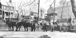 Six horse team and wagon at the scales on lower Main Street in Waterford VA