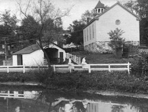 Mill race and weigh station with John Wesley Church in the background