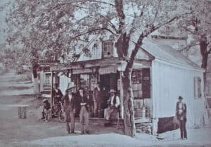 Lewis Hough on the right by the building prdating the current Corner Store at 40283 Main Street c. 1900.